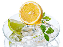 Ingredients for iced tea. Lime, lemon,ice on transparent saucer Stock Photography