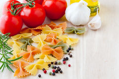 Ingredients for Italian cuisine: farfalle pasta, tomatoes, olive Stock Photography