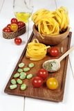 Ingredients Italian cuisine: pasta, tomatoes and olive oil Stock Photography