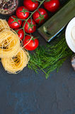 Ingredients for italian dinner. Olive oil, dill, cherry tomatoes Stock Photography