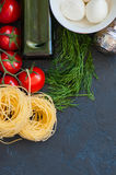 Ingredients for italian dinner. Olive oil, dill, cherry tomatoes Royalty Free Stock Photography