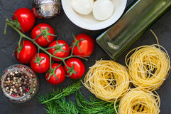 Ingredients for italian dinner. Olive oil, dill, cherry tomatoes Royalty Free Stock Images