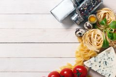 Ingredients for an Italian food recipe. Overhead view of ingredients for an Italian pasta recipe on rustic wood boards with copyspace Stock Images