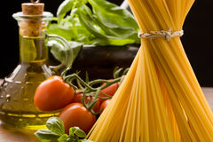 Ingredients for Italian pasta. Photo of different ingredients for italian pasta with tomatoes and basil Stock Photos