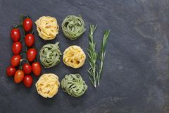 Ingredients for Italian pasta meal with tagliatelle. With mini plum tomatoes with copy space Stock Images