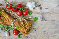Ingredients for an Italian pasta meal with wholemeal spaghetti w Royalty Free Stock Photos