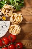 Ingredients for an Italian pasta recipe on rustic wood Royalty Free Stock Image