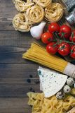 Ingredients for an Italian pasta recipe on rustic wood Stock Photography