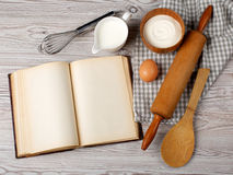 Ingredients and kitchen tools with the old blank recipe book Stock Photography
