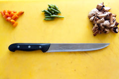 Ingredients and knife are on the cutting board Royalty Free Stock Photography