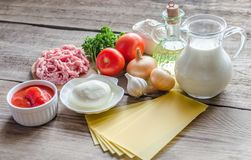 Ingredients for lasagne on the wooden background Stock Photos