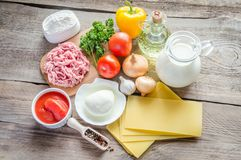 Ingredients for lasagne on the wooden background Stock Image
