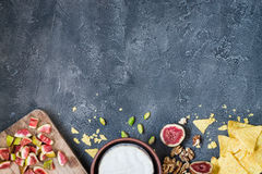 Ingredients layout for baking soft cheese brie with figs, walnuts, pistachios and honey Royalty Free Stock Image