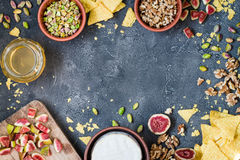Ingredients layout for baking soft cheese brie with figs, walnuts, pistachios and honey Royalty Free Stock Photo