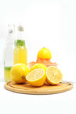 Ingredients for lemonade. Lemons as ingredients to lemonade, bottles and fruit sqeezer Royalty Free Stock Image