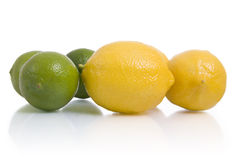Ingredients: lemons and limes. Lemons and limes, isolated on white stock photography