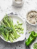Ingredients for lunch - wild rice, asparagus, broccoli, green beans on a light background, top view. Vegetarian food Stock Photography