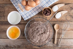 Ingredients for making cake chocolate on a wooden background. Ingredients for making cake chocolate on a wooden background Stock Image