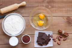 Ingredients for making chocolate chip cookies on a wooden background Royalty Free Stock Photography