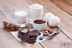 Ingredients for making chocolate chip cookies on a wooden background Stock Image