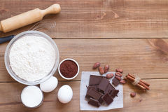 Ingredients for making chocolate chip cookies on a wooden background Royalty Free Stock Photo
