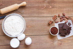 Ingredients for making chocolate chip cookies on a wooden background Stock Photos