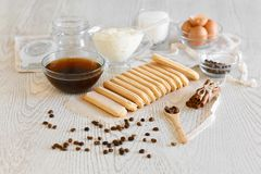 Ingredients for making dessert tiramisu on a light background. Top view with copy space royalty free stock photos