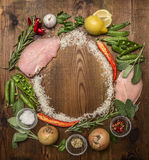Ingredients for making fresh turkey, vegetable,  herbs, spices ,fruit lined circle on wooden rustic background top view Royalty Free Stock Photos