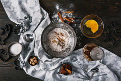 Ingredients for making ginger cookies over scorched wooden background. Ingredients for making ginger cookies over scorched dark wooden background, top view Royalty Free Stock Photography