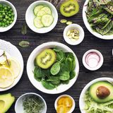 Ingredients for making green salad salads. side dishes, appetizers: sorrel with red veins, spinach, iceberg, pistachios. Avocados, cucumbers, radishes, lemon stock photography