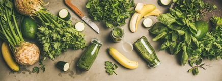 Ingredients for making green smoothie over concrete background stock photos