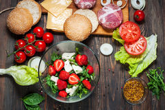 Ingredients for making homemade burger and salad with strawberries, tofu Stock Image