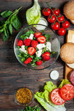 Ingredients for making homemade burger and salad with strawberries, tofu Royalty Free Stock Images
