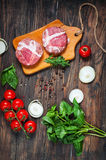 Ingredients for making homemade burger on wooden cutting board. Royalty Free Stock Images