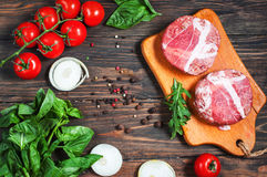 Ingredients for making homemade burger on wooden cutting board. Stock Photography