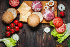 Ingredients for making homemade burger on wooden cutting board Royalty Free Stock Photography