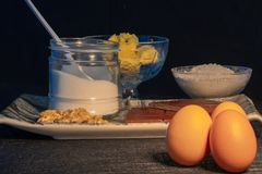 Ingredients for making homemade chocolate cookies. Details of ingredients for making homemade chocolate cookies, flour, eggs, chocolate, butter, sugar and nuts stock image