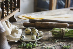 Ingredients for making homemade pasta, rolling pin, quail eggs. Asparagus Stock Photography