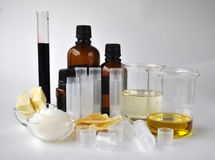Ingredients for making natural cosmetics cacao butter, coconut, almond, jojoba and essential oils with tubes and bottles Royalty Free Stock Photo
