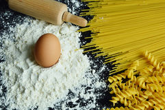 Ingredients for making pasta. Close up from ingredients for making pasta with black background Stock Photo