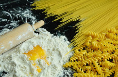 Ingredients for making pasta. Close up from ingredients for making pasta with black background Stock Photos