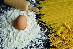 Ingredients for making pasta. Close up from ingredients for making pasta with black background Royalty Free Stock Photo