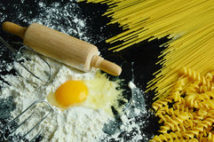 Ingredients for making pasta. Close up from ingredients for making pasta with black background Stock Image