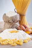 Ingredients for making pasta - flour and eggs. On wooden table surface Royalty Free Stock Images