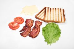 Ingredients for making sandwich. fresh vegetables, tomatoes, bread, becon, cheese. Isolated on white background, top royalty free stock photography