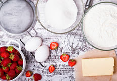 Ingredients for making strawberry cake Royalty Free Stock Photos