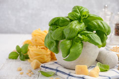 Ingredients for making tagliatelle pasta with green pesto sauce. Royalty Free Stock Images