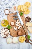 Ingredients for making tagliatelle pasta with mushrooms. Healthy Italian food. Top view Royalty Free Stock Image