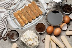 Ingredients for making traditional italian cake tiramisu on concrete table. Ingredients for making traditional italian cake tiramisu on concrete background or stock images