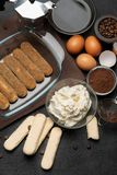 Ingredients for making traditional italian cake tiramisu on concrete table. Ingredients for making traditional italian cake tiramisu on concrete background or royalty free stock images